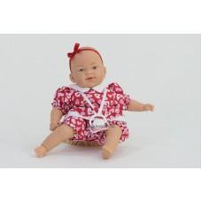Csecsemő baba, piros ruhában, 26 cm